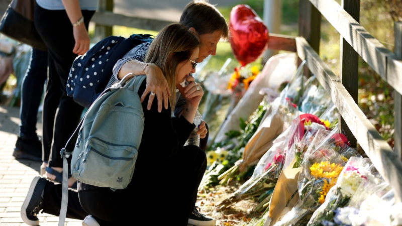 People look at floral tributes for murdered 28-year-old teacher Sabina Nessa in Kidbrooke in south-east London, Friday, Sept. 24, 2021. (AP Photo/David Cliff)