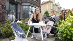 A woman in Toronto gets her used baby gear ready for a curbside pickup with Rebelstork, a managed marketplace for the resale of overstock, open box and used baby gear, in this undated handout photo. (Rebelstork / THE CANADIAN PRESS / HO)