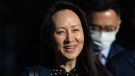 Meng Wanzhou, chief financial officer of Huawei, smiles as she leaves her home in Vancouver on Friday, Sept. 24, 2021. THE CANADIAN PRESS/Darryl Dyck