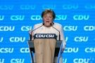 German chancellor Angela Merkel gestures during her speech at a state election campaign in Munich, Friday, Sept. 24, 2021. (AP Photo/Matthias Schrader)