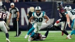 Carolina Panthers running back Chuba Hubbard (30) rushes for a gain against the Houston Texans during the second half of an NFL football game Thursday, Sept. 23, 2021, in Houston. (AP Photo/Eric Christian Smith)