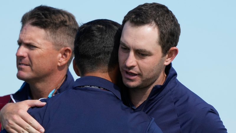 Team USA's Patrick Cantlay and Team USA's Xander Schauffele celebrate after winning their foursome match the Ryder Cup at the Whistling Straits Golf Course Friday, Sept. 24, 2021, in Sheboygan, Wis. (AP Photo/Charlie Neibergall)