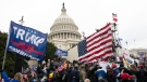 In this Jan. 6, 2021, file photo, supporters of U.S. President Donald Trump besiege the U.S. Capitol in Washington. (AP Photo/Jose Luis Magana, File)