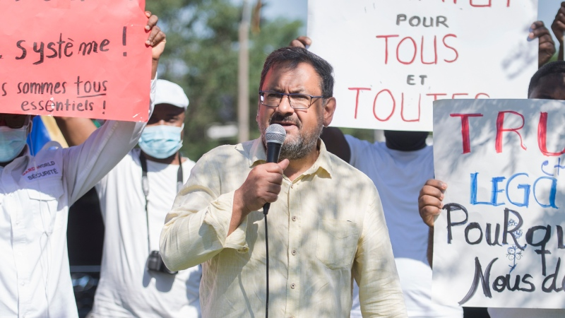 Quebec Solidaire MNA Andres Fontecilla speaks during a protest outside Prime Minister Justin Trudeau's constituency office in Montreal, Saturday, August 15, 2020. THE CANADIAN PRESS/Graham Hughes