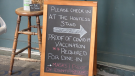 Brewery Bay Food Co., in Orillia, Ont., posts a sign outside its establishment notifying customers proof of vaccination is required on Thurs., Sept. 23, 2021 (Mike Arsalides/CTV News)