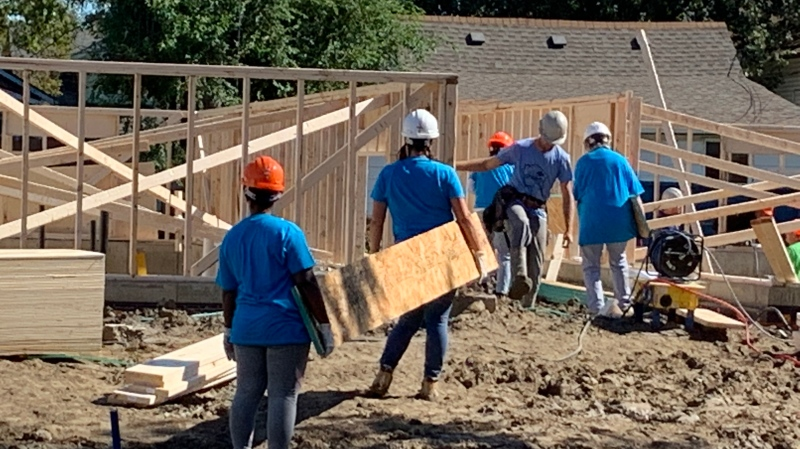 Habitat for Humanity volunteers get started on building new homes in Ford City in Windsor, Ont. on Friday, Sept. 24, 2021. (Chris Campbell/CTV Windsor)