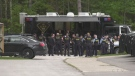 Provincial police officers gather in Wasaga Beach, Ont., on Fri., Sept. 24, 2021, ahead of an unsanctioned car rally over the weekend. (Rob Cooper/CTV News)