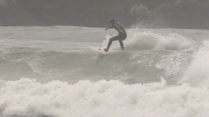 A surfer is pictured in Tofino, B.C.: (CTV News)
