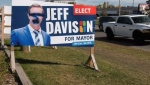 Mayoral candidate Jeff Davison says those responsible for vandalism to his campaign signs are likely upset over his support of the city's COVID-19 plan.