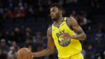 Andrew Wiggins dribbles the ball up the court against the Washington Wizards during an NBA game in San Francisco, March 1, 2020. (AP Photo/Jeff Chiu)