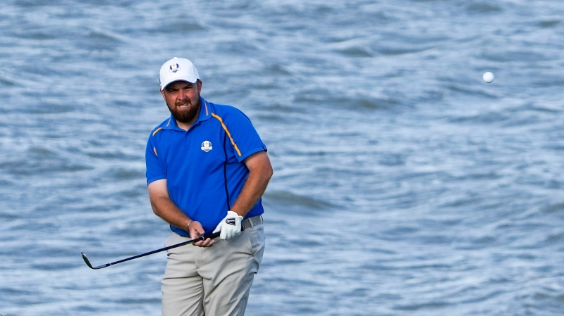 Team Europe's Shane Lowry hits to the 13th green during a four-ball match the Ryder Cup at the Whistling Straits Golf Course, Sept. 24, 2021, in Sheboygan, Wis. (AP Photo/Jeff Roberson)