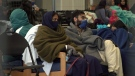 Thousands of Afghan evacuees are waiting in refugee camps before they board flights to their final destinations. (CTV National News)