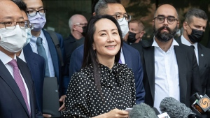 Meng Wanzhou, chief financial officer of Huawei, reads a statement outside B.C. Supreme Court, in Vancouver, B.C., Friday, Sept. 24, 2021. THE CANADIAN PRESS/Darryl Dyck