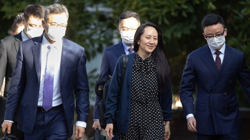 Meng Wanzhou, centre, chief financial officer of Huawei, leaves her home in Vancouver, on Friday, September 24, 2021. THE CANADIAN PRESS/Darryl Dyck