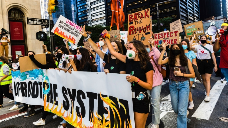 Protesters march down Broadway as part of the Climate Strike demonstrations, Friday, Sept. 24, 2021, in New York. (AP Photo/Stefan Jeremiah)