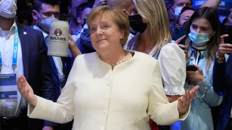 German chancellor Angela Merkel arrives for a state election campaign in Munich, Germany, Friday, Sept. 24, 2021 two days before the General election on Sunday, Sept. 26, 2021. (AP Photo/Matthias Schrader)