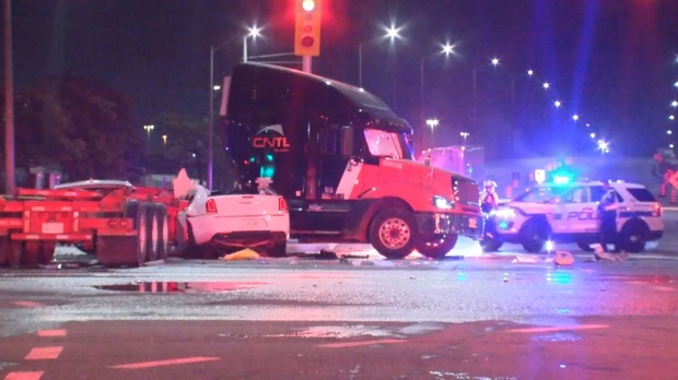 A person is dead and two others are in life-threatening condition after an overnight collision between a tractor trailer and vehicle in Brampton.