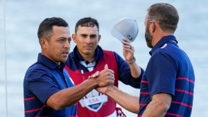 Team USA's Xander Schauffele and Team USA's Dustin Johnson shake hands after winning their four-ball match the Ryder Cup at the Whistling Straits Golf Course Friday, Sept. 24, 2021, in Sheboygan, Wis. (AP Photo/Ashley Landis)