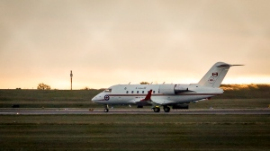 A Canadian Forces Challenger jet takes off from the Calgary International Airport in Calgary, Alta., Saturday, Sept. 25, 2021. Two Canadians who were imprisoned in China for nearly three years are home. Video from CTV shows Prime Minister Justin Trudeau greeting Michael Kovrig and Michael Spavor on the tarmac at the airport in Calgary early this morning. THE CANADIAN PRESS/Jeff McIntosh
