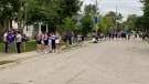 Small gatherings are starting to form on Broughdale Avenue and surrounding area ahead of Western University homecoming celebrations in London, Ont., Sept. 25, 2021. (Brent Lale / CTV News)