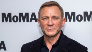 """In this Tuesday, March 3, 2020 file photo, Daniel Craig attends the opening night of the """"In Character: Daniel Craig,"""" film series at the Museum of Modern Art, in New York. (Photo by Charles Sykes/Invision/AP, File)"""