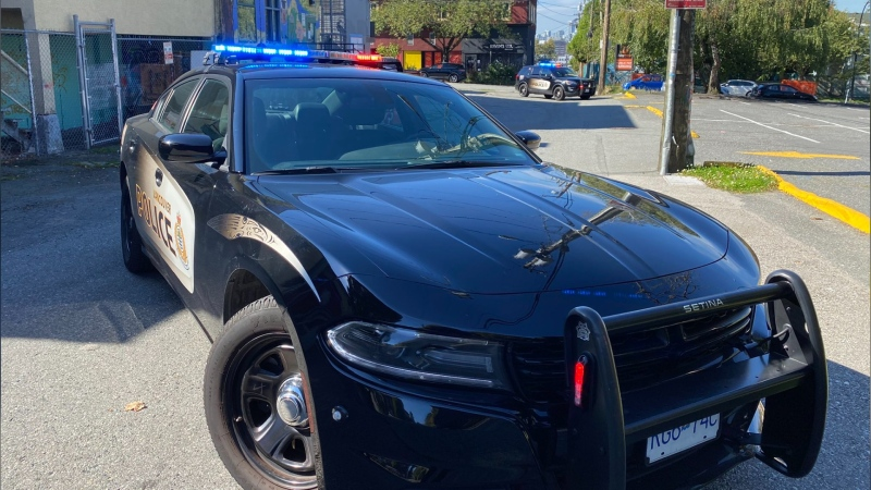A Vancouver Police Department vehicle blocks off an alleyway on the east side of the city on Setp. 25, 2021. (CTV News Vancouver/Jim Fong)