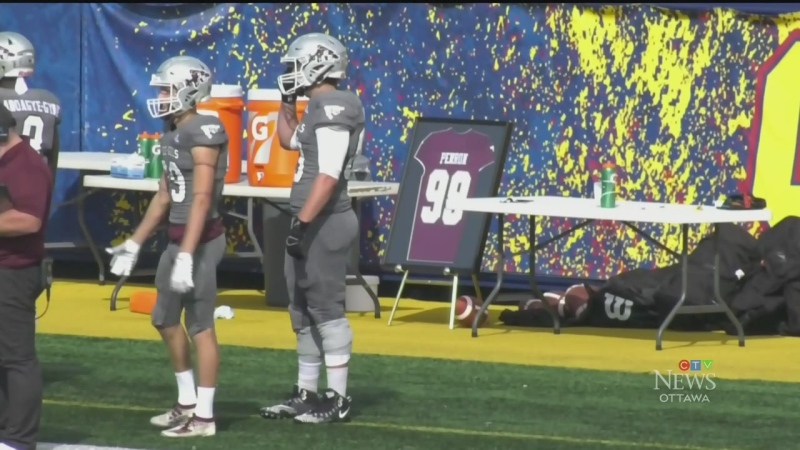 The University of Ottawa Gee-Gees placed Francis Perron's number 99 jersey on the sideline for Saturday's game against Queen's University. Perron died shortly after the Gee-Gees opening game of the season on Sept. 18. (Kimberley Johnson/CTV News Ottawa)