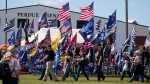 """Supporters file into the Georgia National Fairgrounds in Perry, Ga., to attend former president Donald Trump's """"Save America"""" rally Saturday, Sept. 25, 2021. (AP Photo/Ben Gray)"""