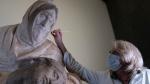 An art restorer works on Michelangelo's Pietà, known as the Bandini Pietà, during the final phases of its restoration, at the Museo dell'Opera del Duomo, in Florence, Italy, on June 7, 2021. (Opera di Santa Maria del Fiore/Claudio Giovannini via AP)