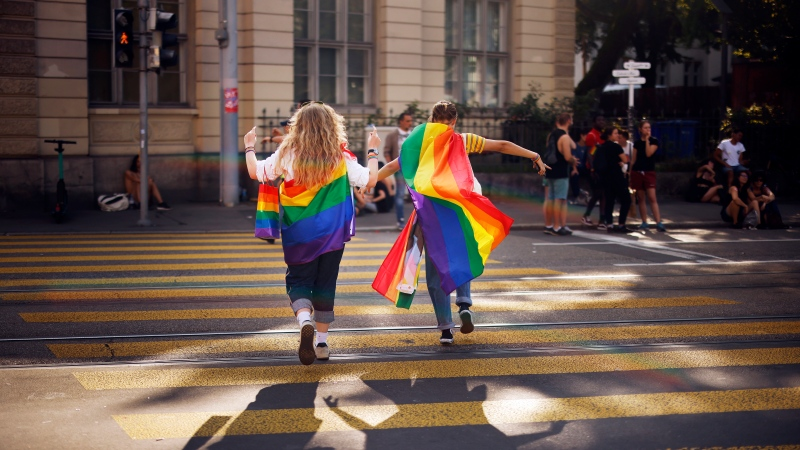 """In this Saturday, Sept. 4, 2021 file photo, people take part in the Zurich Pride parade in Zurich, Switzerland, with the slogan """"Dare. Marriage for all, now!"""" (Trau Dich. Ehe fuer alle. Jetzt!) for the rights of the LGBTIQ community. (Michael Buholzer/Keystone via AP, File)"""