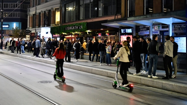 People out on the streets to celebrate the end of the COVID-19 restrictions, in Oslo, Saturday, Sept. 25, 2021. (Naina Helen Jama/NTB via AP)