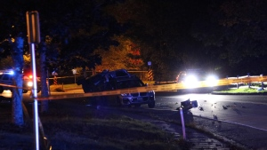A vehicle is flipped on its side and debris is scattered on the road after a car crash on Southwest Marine Drive near Stadium Road on Sept. 26, 2021. (CTV News Vancouver/Ryan Stelting)