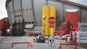 The Saddledome, home of the Calgary Flames, is seen in Calgary, Thursday, March 12, 2020. Health experts are concerned the capacity limits at the arena are too high as the NHL preseason is set to begin. THE CANADIAN PRESS/Jeff McIntosh