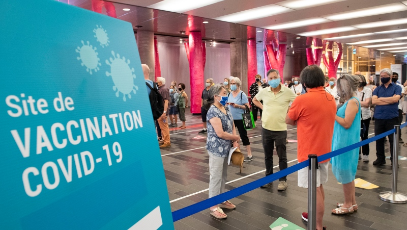 The Palais des congres COVID-19 vaccination site in Montreal will close for two days and reopen with a smaller footprint. THE CANADIAN PRESS/Graham Hughes