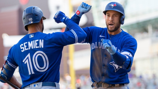 Toronto Blue Jays' George Springer, right, celebrates his home run with Marcus Semien in the fifth inning of a baseball game against the Minnesota Twins, Sunday, Sept. 26, 2021, in St. Paul, Minn. (AP Photo/Andy Clayton-King)