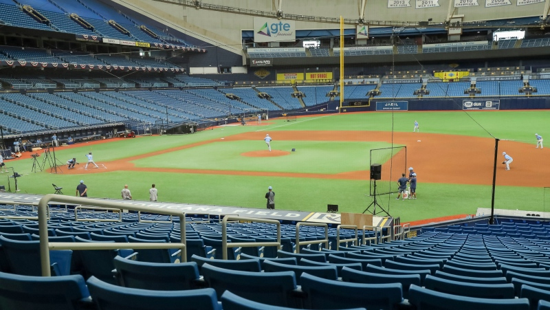 A general view of Tropicana Field during Tampa Bay Rays baseball practice in St. Petersburg, Fla. A sign promoting the owner's plan to split games between Tampa and Montreal will appear during the playoffs. (AP Photo/Mike Carlson)