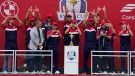 """Team USA players hold up a """"W"""" for Wisconsin after the Ryder Cup matches at the Whistling Straits Golf Course Sunday, Sept. 26, 2021, in Sheboygan, Wis. (AP Photo/Ashley Landis)"""
