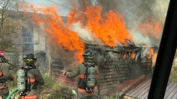A garage fire originating from a tarped structure spread to a detached garage on Sept. 26. (Saskatoon Fire Department)