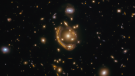 """This image, taken by the Hubble Space Telescope, shows an Einstein ring called the """"Molten Ring"""", which is a galaxy that is 9.4 billion light years away. (IMAGE: Saurabh Jha (Rutgers, The State University of New Jersey)"""