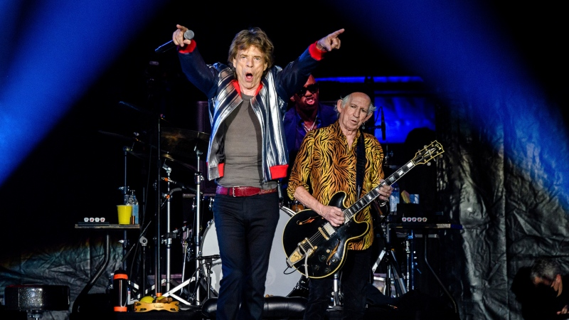"""Mick Jagger, from left, Steve Jordan and Keith Richards of the Rolling Stones perform during the """"No Filter"""" tour at The Dome at America's Center, Sunday, Sept. 26, 2021, in St. Louis. (Photo by Amy Harris/Invision/AP)"""