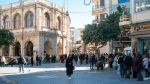 People queue outside the town hall in Chania, on the Greek island of Crete, Wednesday, Feb. 24, 2021, to conduct rapid tests for the COVID-19. (AP Photo/Harry Nakos)