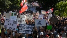 A crowd begins a march following a demonstration to protest measures taken by public health authorities to curb the spread of COVID-19, in Toronto, on Sept. 18, 2021. (Chris Young / THE CANADIAN PRESS)