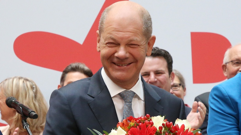 Olaf Scholz, the SPD's candidate for chancellor, on stage a day after the Bundestag elections. (Wolfgang Kumm/Picture Alliance/Getty Images)
