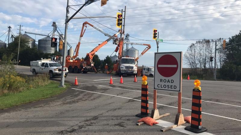 Crews repair a hydro pole damaged in a crash (Chris Thomson / CTV Kitchener)