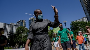 Green Party Leader Annamie Paul canvasses a neighbourhood after launching her election campaign in the riding of Toronto Centre, on Sunday, Aug. 15, 2021. THE CANADIAN PRESS/Christopher Katsarov
