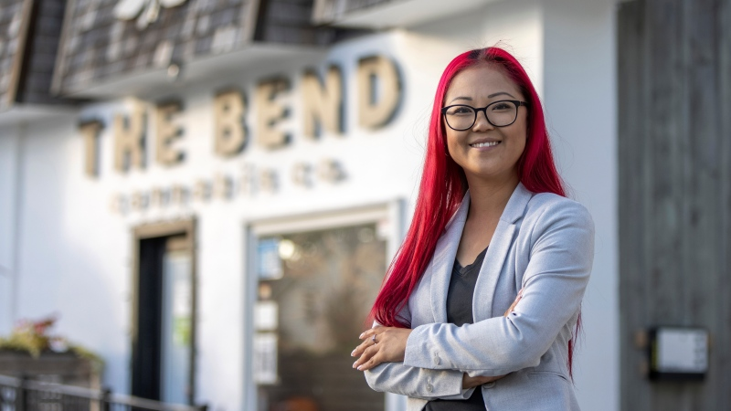 Laura Bradley, owner of Behind the Bend, poses at her cafe in Grand Bend, Ont. on Thursday, September 16, 2021. THE CANADIAN PRESS/Nicole Osborne