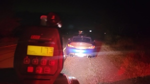 A car is pulled over after radar allegedly clocked the vehicle travelling 173km/h in an 80km/h zone on Highway 26 in Springwater Township, Ont., on Sun., Sept. 26, 2021 (OPP_CR)