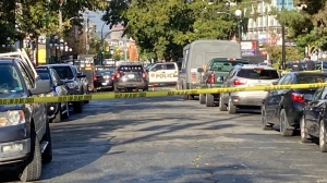 A witness tells CTV News that a Victoria police officer was trying to remove someone from a vehicle when the officer was struck and pinned between the car and a dumpster. (CTV News)
