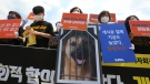 South Korean animal rights activists stage a rally opposing South Korea's culture of eating dog meat near the presidential Blue House in Seoul, South Korea, Thursday, July 16, 2020. (AP Photo/Ahn Young-joon)