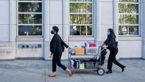 Paralegals arrive at the Brooklyn Federal Court House, in New York on Sept. 27, 2021. (Brittainy Newman / AP)